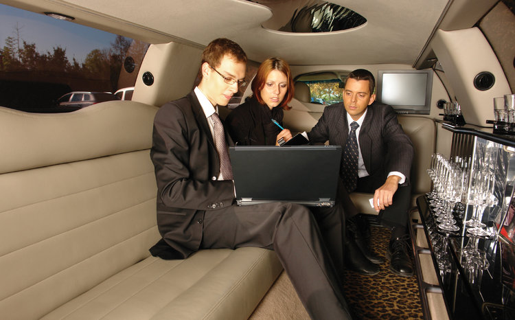 business people in limo